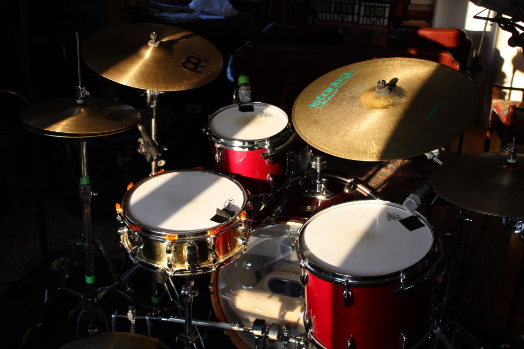 View of the drum kit from the back right