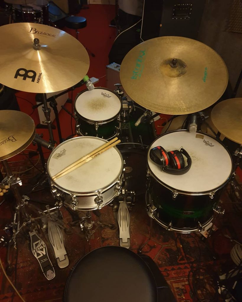 Picture of the my drum kit including the new mic setup for Skype teaching